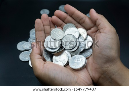 Close up of coins to stack of coins, Business Growth concept, There is money coins to stack of coins. Financial risk. #1549779437