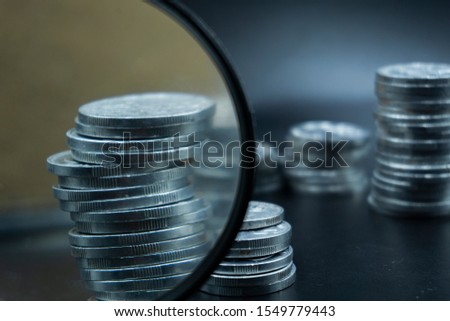 Close up of coins to stack of coins, Business Growth concept, There is money coins to stack of coins. Financial risk. #1549779443