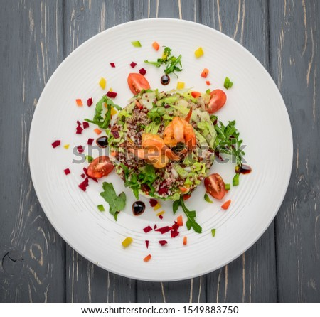 Fresh salad with vegetables, sprouted grains and shrimp, on wooden background #1549883750