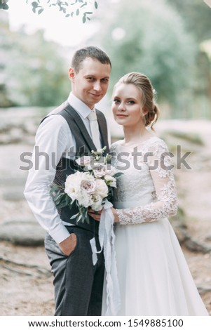 Beautiful couple at sunset in the Park. Wedding ceremony with arch in the forest.  #1549885100