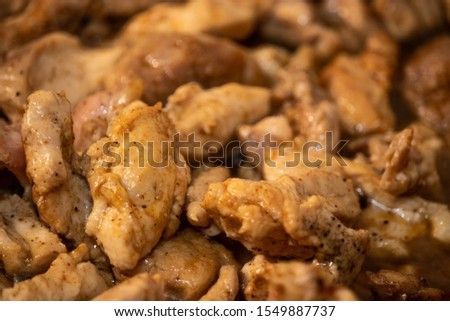 Marinated torn cut chicken bits being cooked, halfway cooked #1549887737