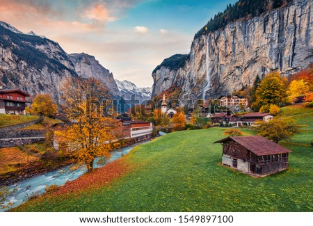 Impressive outdoor scene of Swiss Alps, Bernese Oberland in the canton of Bern, Switzerland, Europe. Magnificent autumn sunrise in Lauterbrunnen village. Beauty of countryside concept background. Royalty-Free Stock Photo #1549897100