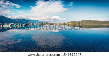 Panoramic summer view of small fishing town - Mikrovivos. Attractive morning seascape of Aegean sea. Beautiful world of Mediterranean countries, Greece, Europe. Traveling concept background. #1549897247