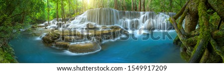 Panoramic beautiful deep forest waterfall in Thailand Royalty-Free Stock Photo #1549917209