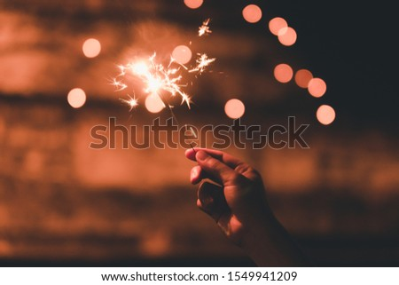 The spark stick is called cold fire. That the woman was holding to spark during the festival of happiness and brightness. #1549941209