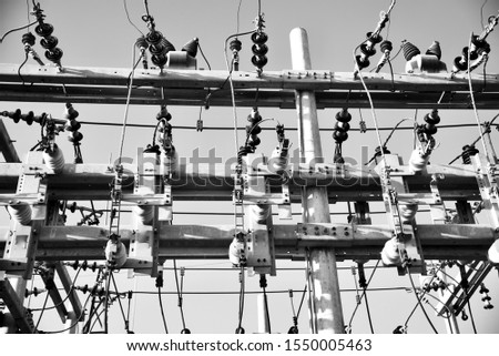 Electric supply equipments with wires in a power plant black and white photo #1550005463