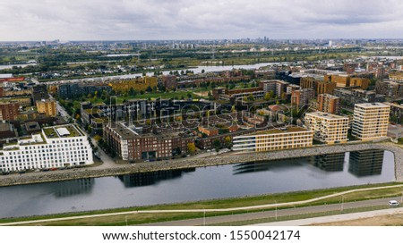 Amsterdam, Holland, The Netherlands November 04 2019: construction site by the Island of Ijburg during daylight shot with a drone from above #1550042174