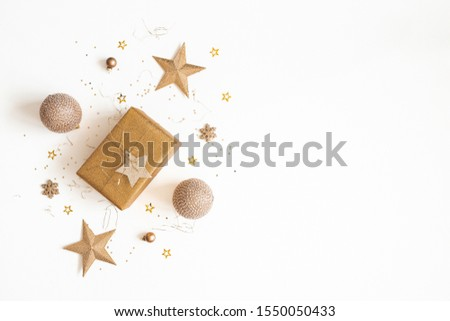 Christmas composition. Gift box, golden decorations on white background. Christmas, winter, new year concept. Flat lay, top view, copy space #1550050433