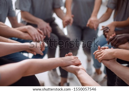 close up. a group of people holding each other's hands #1550057546