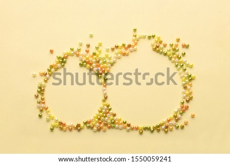 Christmas Bauble made of decoration elements on yellow background. Flat lay. Contemporary design. Contemporary art. Creative conceptual and colorful collage. #1550059241
