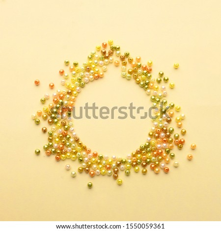 Christmas Bauble made of decoration elements on yellow background. Flat lay. Contemporary design. Contemporary art. Creative conceptual and colorful collage. #1550059361