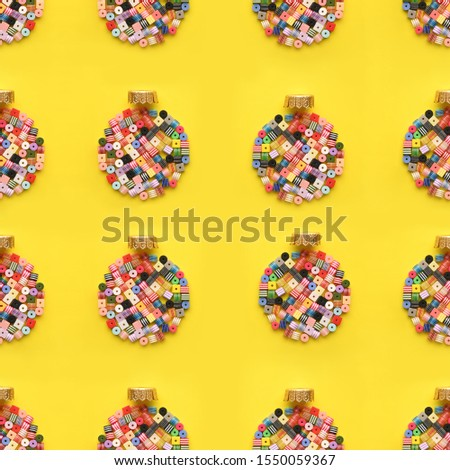 Christmas Bauble made of decoration elements on yellow background. Flat lay. Contemporary design. Contemporary art. Creative conceptual and colorful collage. #1550059367