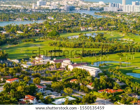 MIAMI BEACH, FL, USA - OCTOBER 25, 2019: Aerial photo Miami Beach La Gorce country club golf course landscape  #1550135459