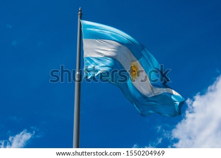 The flag of Argentina (Bandera argentina - Bandera Nacional) is a horizontal triband of light blue (top and bottom) and white with the Sun of May centered). Buenos Aires, Argentina #1550204969