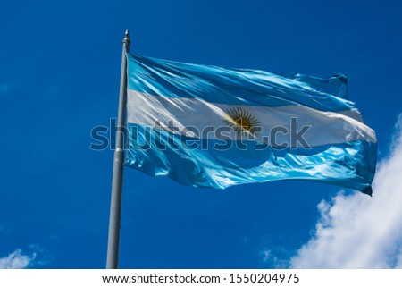 The flag of Argentina (Bandera argentina - Bandera Nacional) is a horizontal triband of light blue (top and bottom) and white with the Sun of May centered). Buenos Aires, Argentina #1550204975