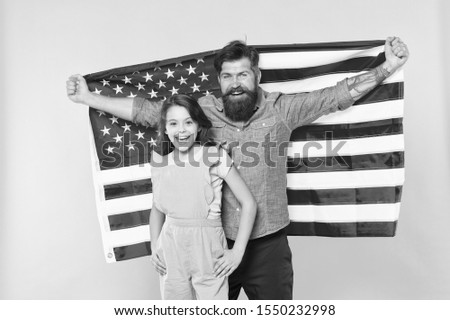 Patriotic fourth of july. Patriotic family celebrating independence day. Bearded man and small child showing patriotic spirit. Embracing patriotic traditions of the usa and emphasizing patriotism. #1550232998