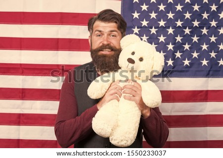 The enthusiastic spirit. Patriotic man holding teddy bear on independence day. Bearded hipster being patriotic for usa. Patriotic feelings. #1550233037