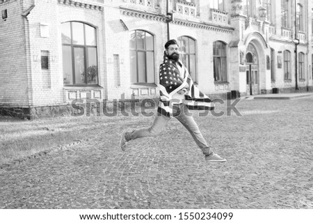 Patriotic spirit. Patriotic man jumping with american flag. Independence day. Bearded hipster patriotic citizen. Happy and proud. Join celebration. Patriotic guy expressing happiness in street. #1550234099