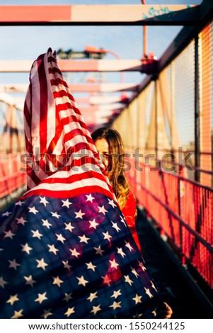 Beautiful blonde woman with American flag in New York. #1550244125