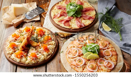 Pizza Smoked Salmon Cream Cheese -Yoko Pizza Combo 3 set Pizza. Wood background.  #1550256203