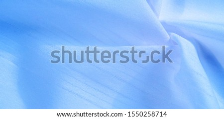 texture background, pattern.  silk blue fabric. From Telio, this organza has a thin, open weave that is thicker and sharper than silk gauze. Use this luxurious fabric for anything. The possibilities  #1550258714