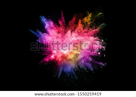 abstract colored dust explosion on a black background.abstract powder splatted background,Freeze motion of color powder exploding/throwing color powder, multicolored glitter texture. #1550259419