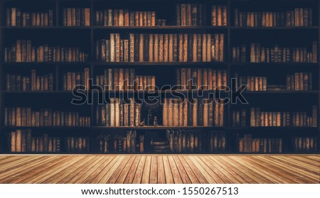 blurred bookshelf Many old books in a book shop or library #1550267513