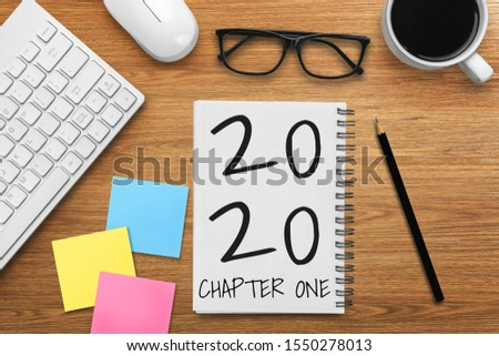 New Year Resolution Goal List 2020 - Business office desk with notebook written in handwriting about plan listing of new year goals and resolutions setting. Change and determination concept. #1550278013