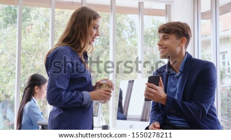 Happy businesswoman and businessman having conversation in modern office. Business corporate and community concept. #1550278211