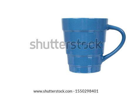 Blue ceramic cup, mug for coffee and tea, kitchen pottery. Isolated on white background. Copy space template, mockup. #1550298401