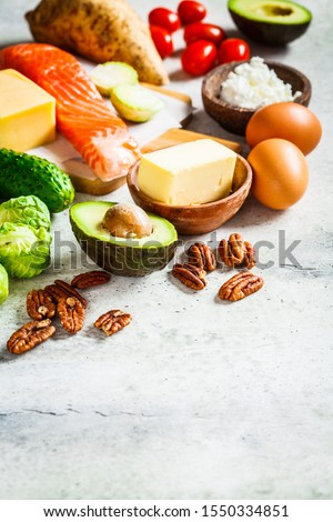 Keto diet food concept. Fish, eggs, cheese, nuts, butter and vegetables - ingredients keto diet. #1550334851