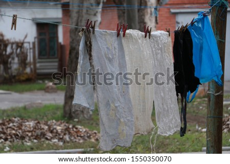 old rags dry on a rope in the yard #1550350070