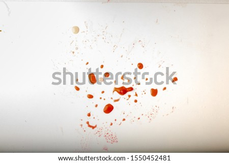 Glossy red liquid droplets, splatters isolated. drops of red juice on a white dirty background #1550452481