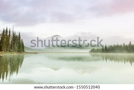 Serene beautiful lake in morning mountains, Oregon, USA. Royalty-Free Stock Photo #1550512040