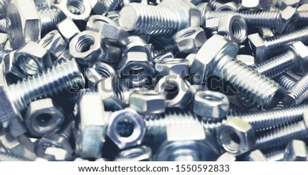 Abstract industrial background. Bolts and nuts. Many metalware. #1550592833