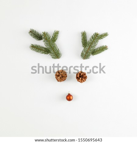 Minimalist composition on a white background. Christmas decorations, place for your product. Flat lay, Copy spay, Winter time. December background of winter. Fir branches. #1550695643