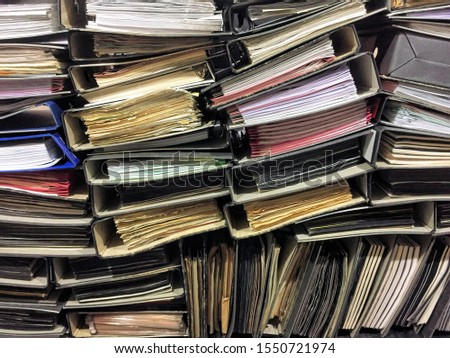 Stack of obsolete documents in old file folders #1550721974
