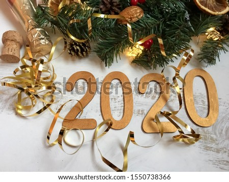 happy new year 2020.  Christmas composition with elements of New Year's decor, gold-colored numbers on a white background, background for the calendar.  holidays concept symbols #1550738366