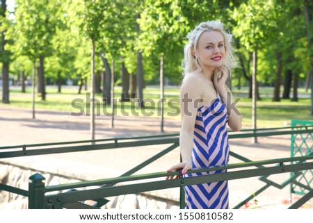 portrait of young cute girl in a summer dress #1550810582