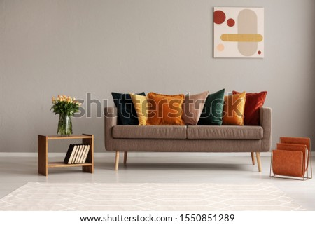 Vintage style grey living room interior with trendy sofa #1550851289