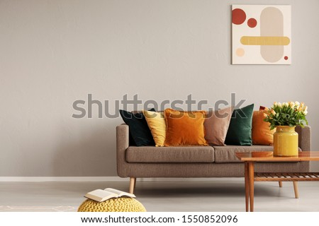 Retro style in beautiful living room interior with grey empty wall #1550852096