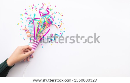 Celebration party and anniversary concepts ideas with woman hand holding colorful confetti,paper art on white color background.copy space #1550880329