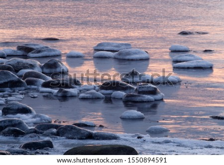 Sunset-colored winter coastl landscape with the freezing Baltic Sea in Estonian seacoast #1550894591