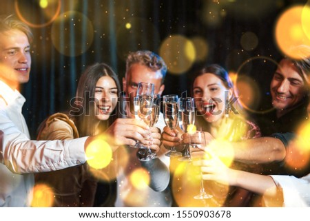 Group of cheerful young people have party and celebrating new year indoors. #1550903678