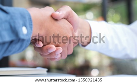 Businessmans handshake. Successful businessmen handshaking after good deal. Business partnership meeting concept. #1550921435