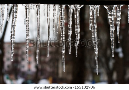 icicles which are hanging down from a roof Royalty-Free Stock Photo #155102906