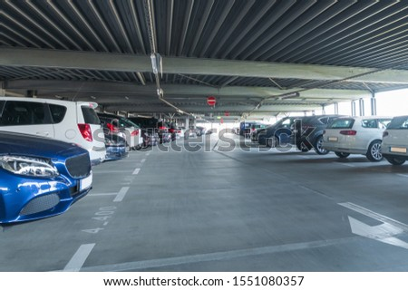 Cars are in a parking garage.  #1551080357