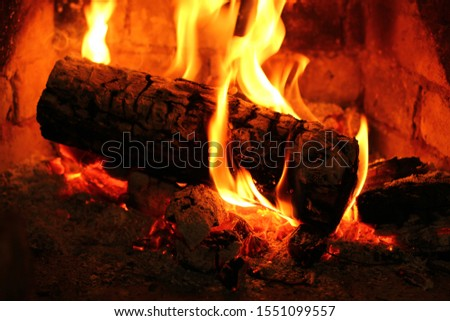 Firewood in the fireplace. Fire in the fireplace #1551099557