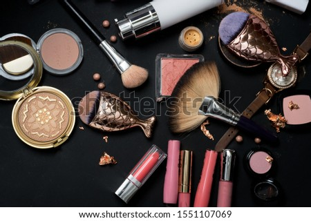 Set of bronze powder with makeup brushes on black background #1551107069