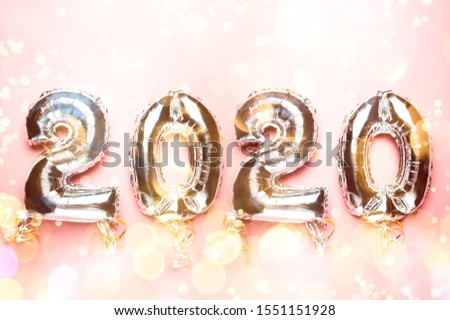 Balloon Bunting for celebration of New Year 2020 made from Silver Number Balloons. Holiday Party Decoration or postcard concept with top view and copy space. #1551151928